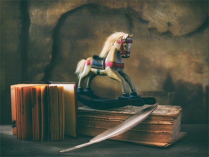 still life, натюрморт,    винтаж,  ретро, книга, книги, деревянная лошадка, игрушка, перо птицы, натюрморт с деревянной лошадкойphoto preview