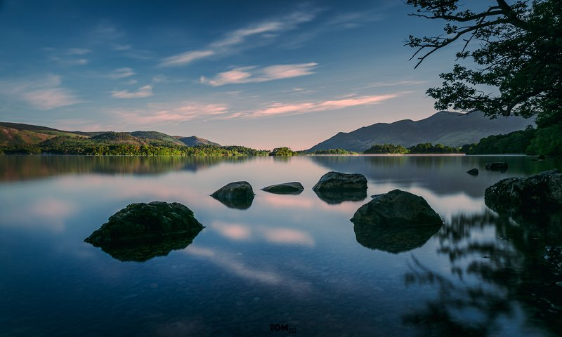 stones rocks stone rock water lake reflection sky clouds tree mountains blue bluehours moody cold england uk  \