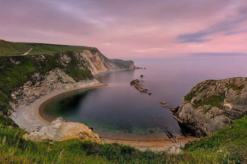 Dorset coast, North Sea, UK, long exposure, sunset, Jurassic coast, summer Soft sunset and light pink haze above Man O\' War Beach. Dorset coast. photo preview