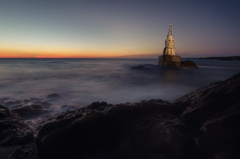 Sunrise near Lighthouse Ahtopol Bulgariaphoto preview