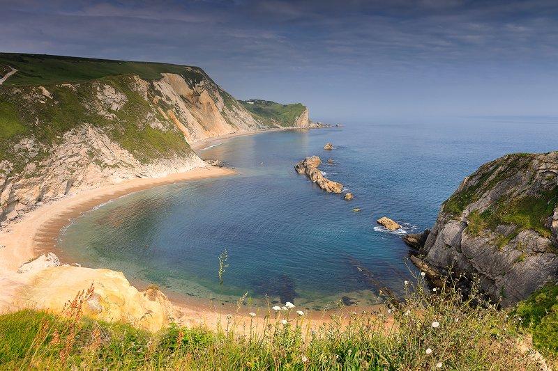 summer, Dorset, North Sea, UK, long exposure, sunset, Jurassic coast The Man O\' War Beach on the Dorset Coast. West Lulworth, UKphoto preview