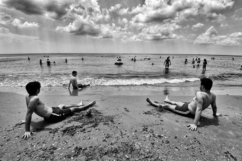 Men on the beachphoto preview