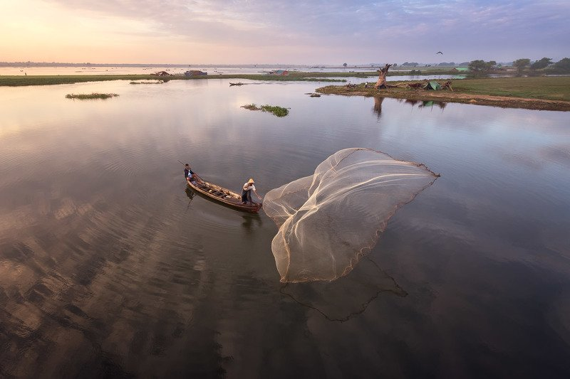amarapura, asia, asian, balance, birma, blue, boat, burma, burmese, catch, countryside, culture, dawn, early, fish, fisherman, fishing, freshwater, kayak, labor, lake, landscape, life, man, mandalay, morning, myanmar, nature, net, outdoor, paddle, reflect The Gathering - Earthphoto preview