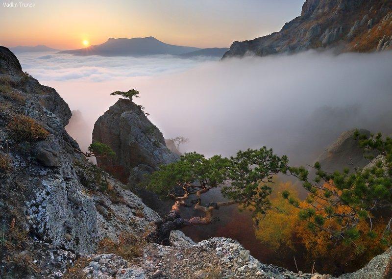 Закат над морем облаковphoto preview