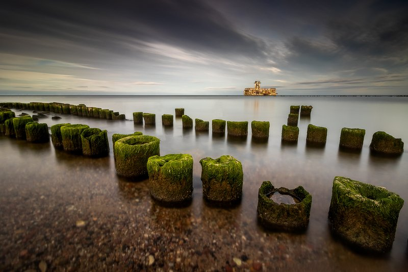 #landscape #seascape #waterscape #reflection #calm #sky #clouds #stones #canon #longexposure #nature #beautiful #colorful #jetty #seaweed #wood #dusk Torpedowniaphoto preview
