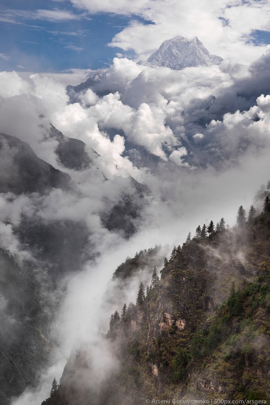 sky, landscape, nature, travel, rock, rain, tourism, wood, mountain, valley, cloud, hill, panoramic, outdoors, daylight, rainforest, summit, environment, trek, trekking, scenic, monsoon, mountain, peak, himalayan, Nepal, Himalayas, Annapurna, Nilgiri, Bas Nilgiri Summit. Monsoon time in Nepalphoto preview
