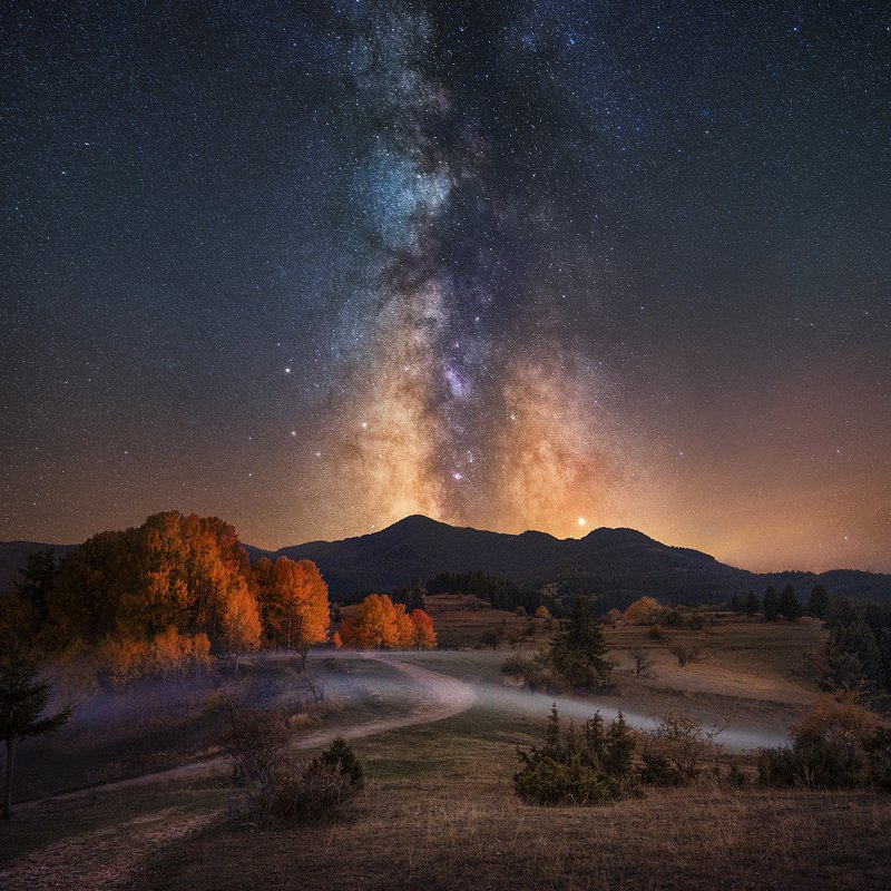 Autumn over Rodopi mountain, Bulgaria, with Milky Way and Jupiter above.photo preview