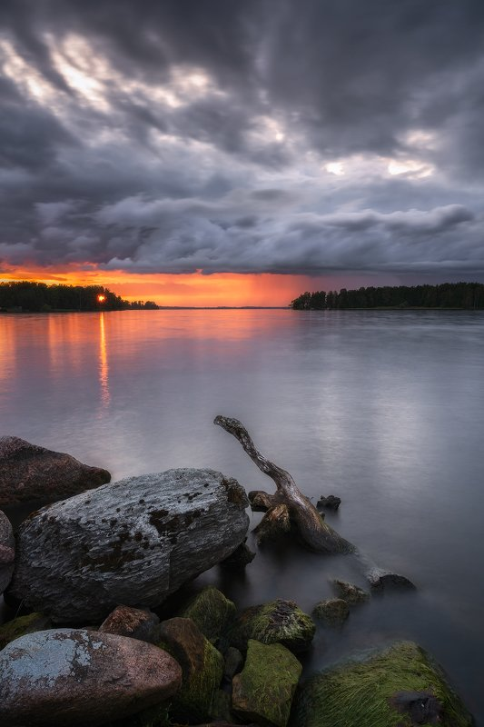 After Glow, Beach, Blue, branch, Clouds, Evening, Evening Glow, harmony, Hjalmaren, lake, Lichenes, Lichens, moss, nature, nature sight, outdoors, Peace, Rock, Scandinavia, Sunset, Sweden, tranquility, trees, Water Unexpected Breakthroughphoto preview
