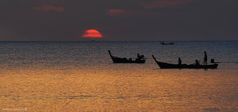 пейзаж рыбаки, солнце и океан.photo preview