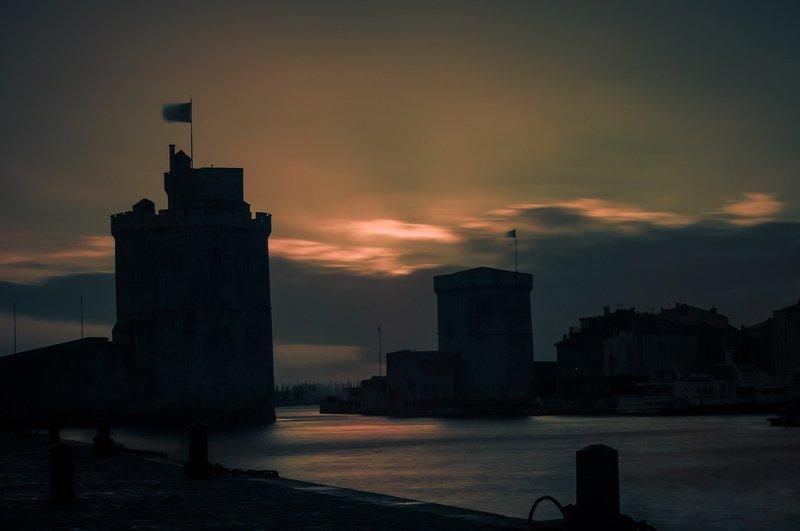 city; dawn; sunlight;winter; sea; light; france Dawn hivernal sur les tours de La Rochellephoto preview