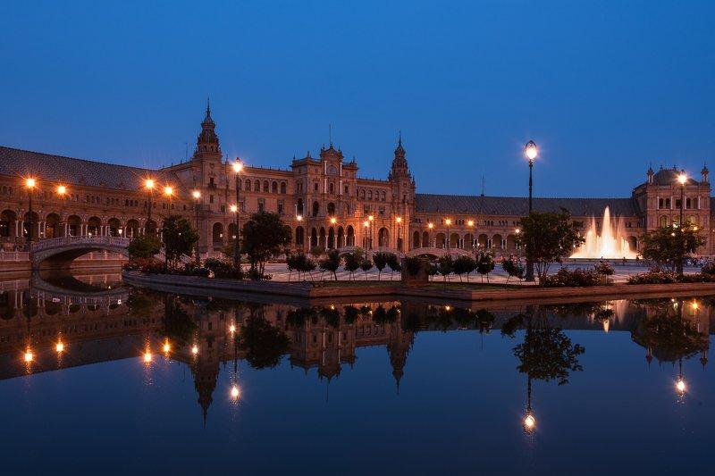 night; place; sevilla; cityscape; water; reflections; travel destinations; famous place; architecture; outdoors Plaza de Españaphoto preview