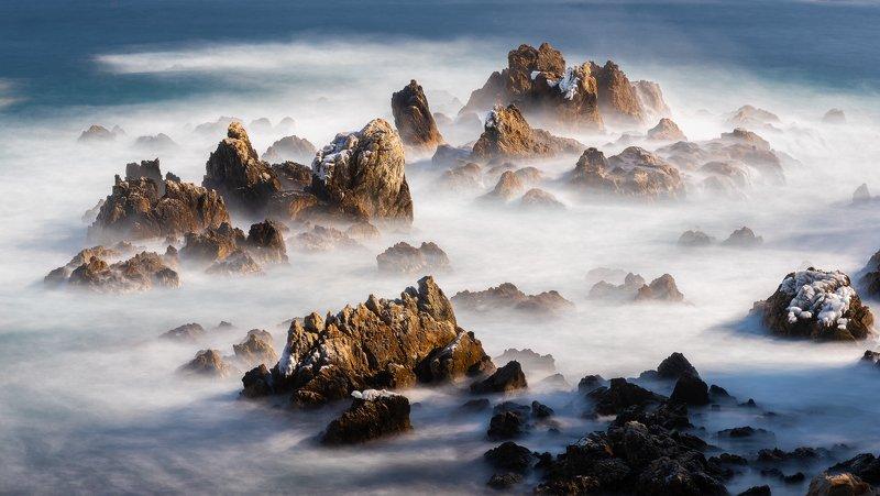 rocks,clouds,mountain,range,peak,snow,fog,rugged,winter,sea Winter mountainphoto preview