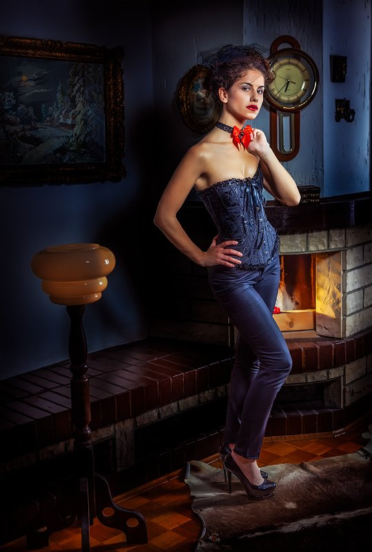 girl, lamp, fireplace, clock, painting, tie, high heels, corset Influencephoto preview