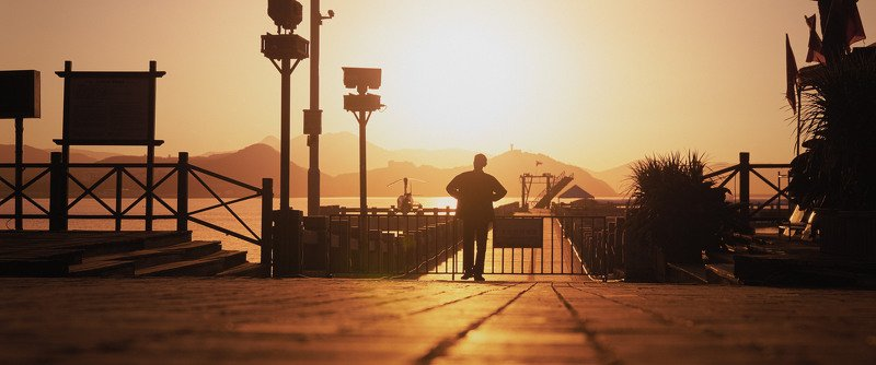 man, morning, pier, sun, sunshine, sunrise, cinematic, cine, colors, colorgrade, colorgrading Man at the pier in the morningphoto preview