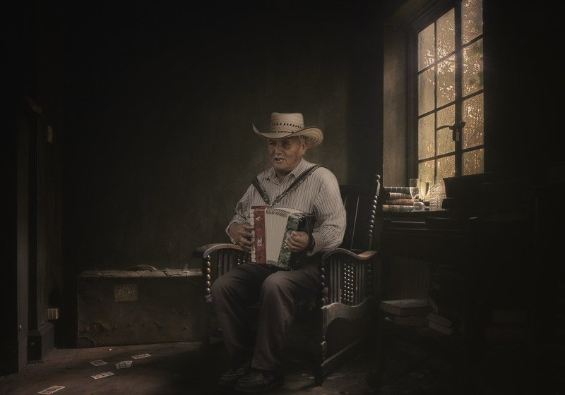 мужчина, кресло, окно, гармонь Гармонистphoto preview