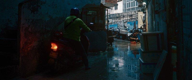 bike, woman, light, shadow, street, narrow, cinematic, cine, colors, colorgrading, colorgrade Near the fish marketphoto preview