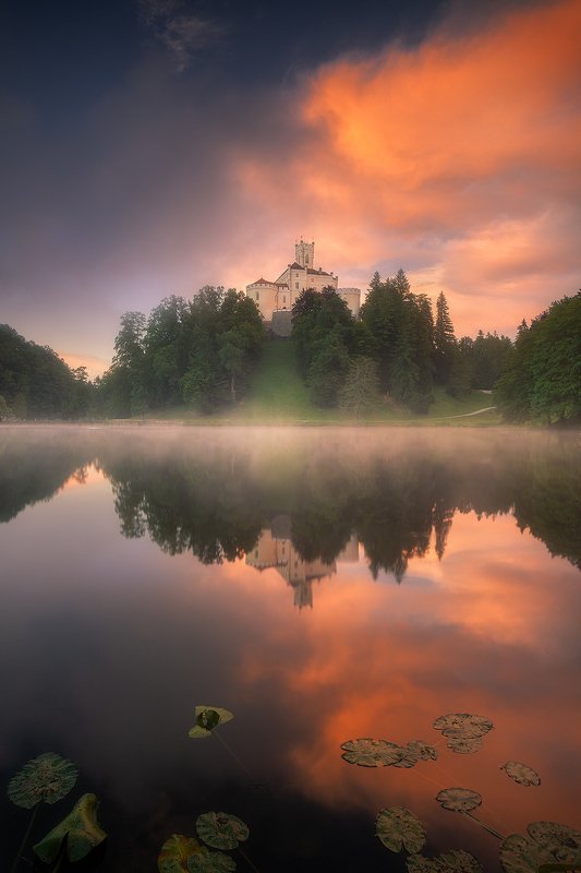 trakoscan castle fog storm clouds reflection landscape  trakoscan castle photo preview