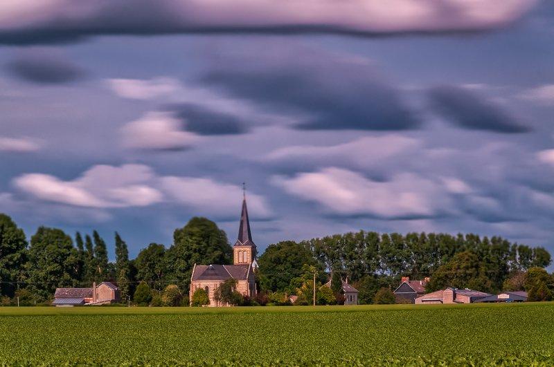 landscape: sunbeam; clouds; field; light; long exposure; normandy; france Sunbeam and cloudsphoto preview