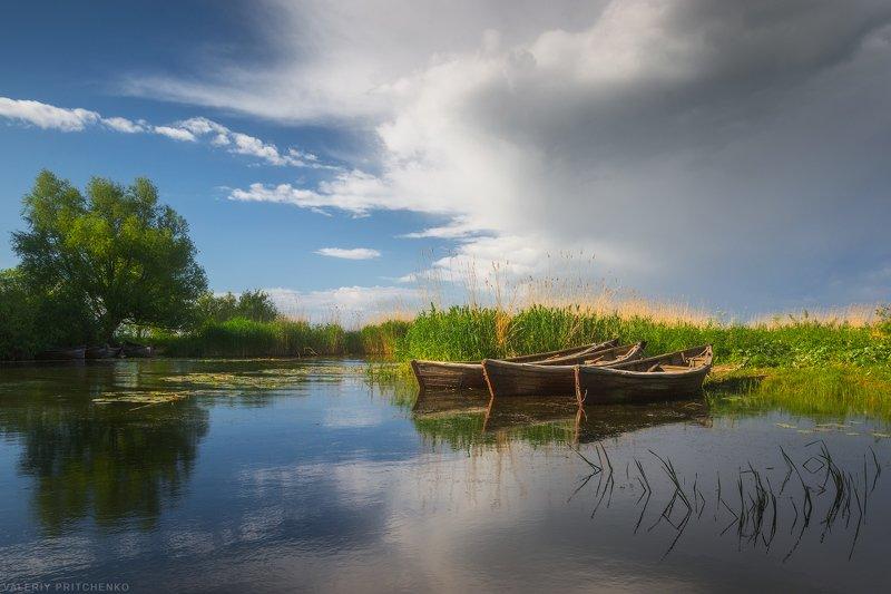 Маленькая бухта для рыбацких лодок в поселке Заливино.photo preview