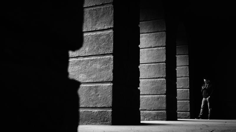 layer, shadow, light, columns, arches, man, alone, dark The layersphoto preview