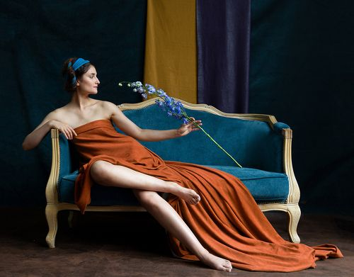 Lady with blue flower